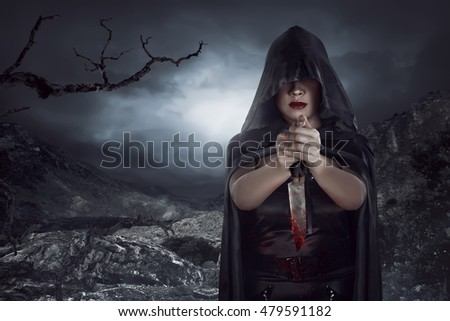 Asian woman holding knife covered blood on the rock mountain