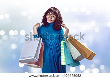 Asian woman holding shopping bag. Shopping sale concept