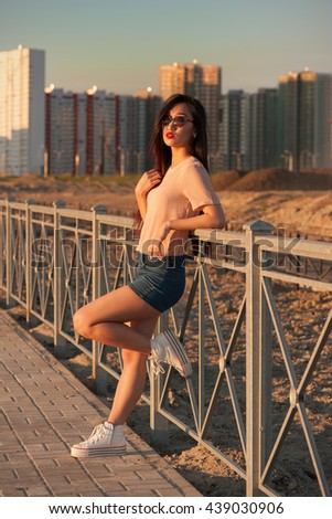 Asian woman in city outdoors - stock photo