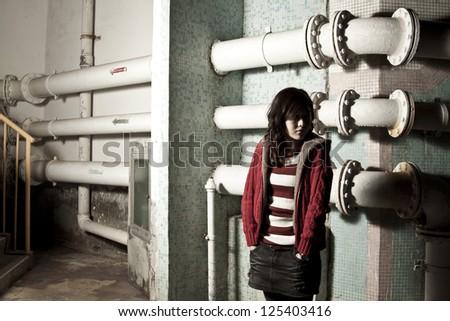 Asian woman in dark showing sorrow mood - stock photo