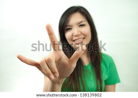 Asian woman in green set, hand sign I love you - stock photo