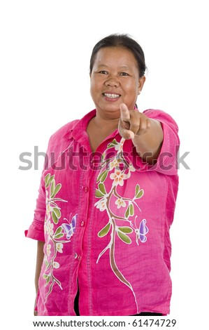 asian woman in her 50s pointing at you, isolated on white
