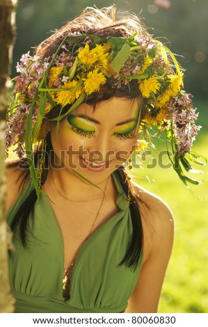 Asian woman in nature with chaplet on head