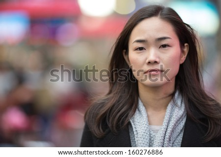 Asian woman in New York City Times Square portrait sad face