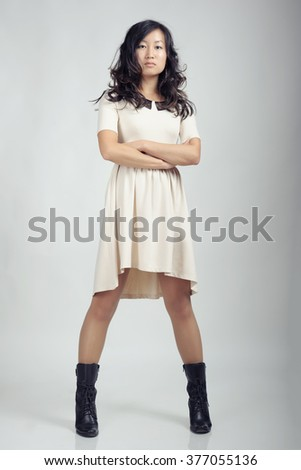 Asian woman in white dress - stock photo