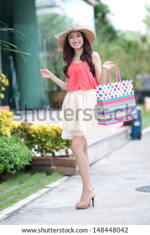 Asian woman is shopping on street