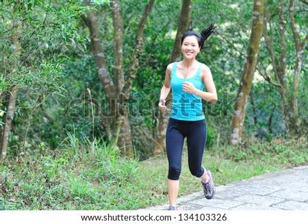 asian woman jogging - stock photo