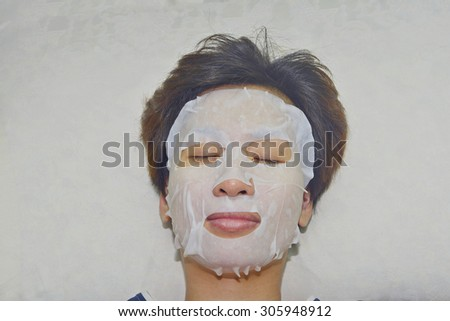 Asian woman masking treatment her face