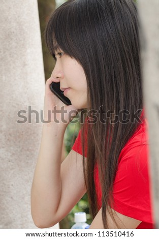 Asian woman on cell phone - stock photo