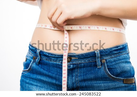 asian woman on diet measuring her fat - stock photo