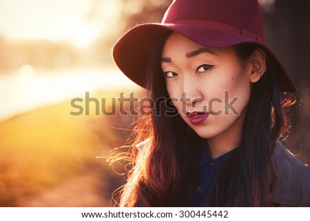 Asian woman outdoors - stock photo