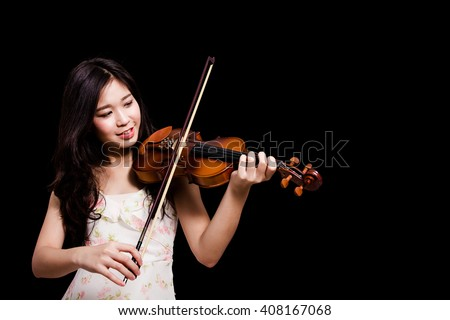 Asian woman playing the violin over  black background