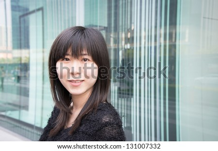 Asian woman portrait at urban shopping centre - stock photo
