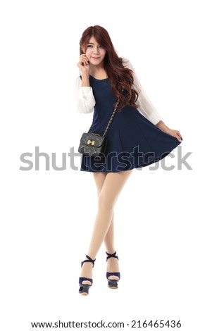 Asian woman posing in blue contrast white sleeve fringe tweed dress isolated on white background.