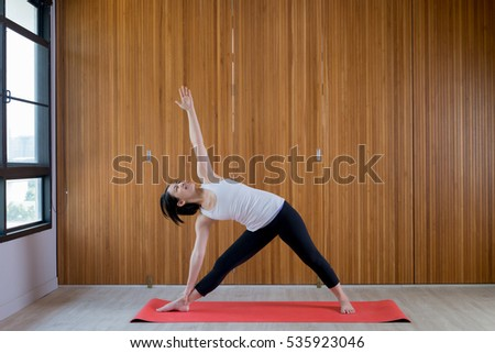 asian woman practice yoga at home