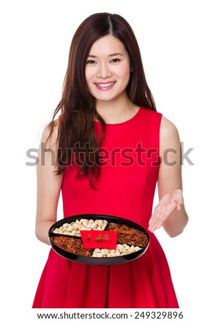 Asian Woman present with snack box