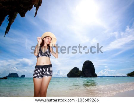 Asian woman relaxing on the beach - stock photo