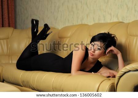 Asian woman rest on sofa