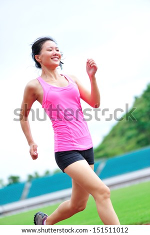 asian woman runner running in the playground outdoor - stock photo