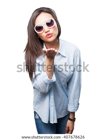 asian woman sending kisses - stock photo