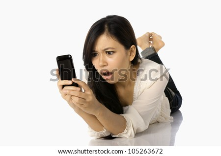 Asian woman shock see news on the cellphone, isolated on white background - stock photo