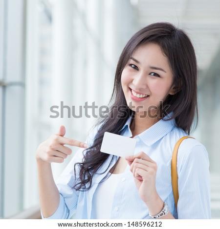 Asian woman shopping - stock photo