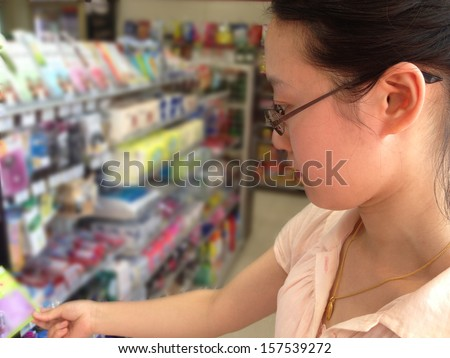 Asian woman shopping in a store - stock photo