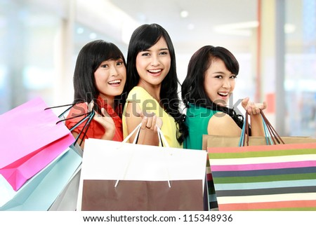 asian woman shopping with friends together isolated on white background - stock photo