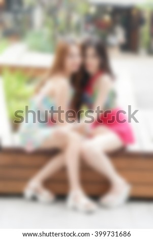 asian woman sit and pose in the patio