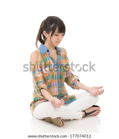 Asian woman sit in lotus pose, full length portrait on white. - stock photo