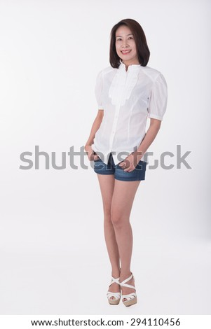 asian woman standing on white background - stock photo