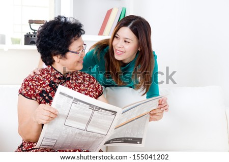 Asian woman talking to her mother - stock photo
