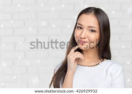 Asian woman thinking  - stock photo