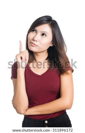 Asian woman thinking in looking pensive and happy in casual clothes isolated on white background. - stock photo