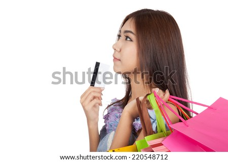 Asian woman touch credit card to chin think what to buy  isolated on white background