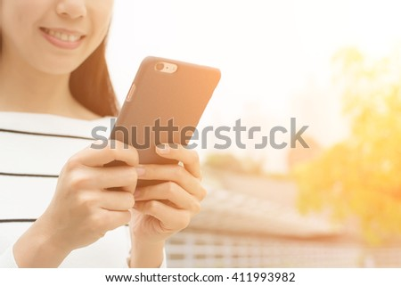 Asian Woman use of cellphone - stock photo