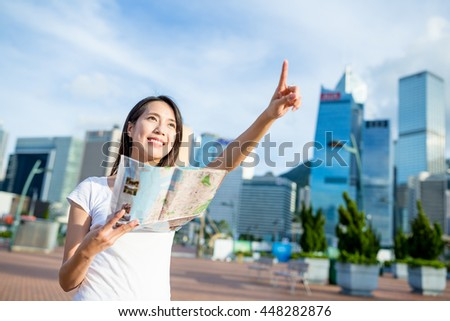 Asian woman use of city map to find the location