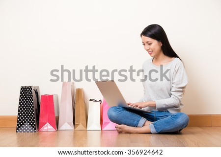 Asian woman use of the notebook computer for online shopping - stock photo