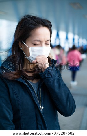 Asian woman wear face mask for protection - stock photo