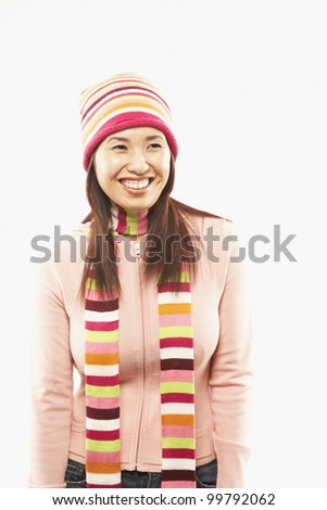 Asian woman wearing matching hat and scarf