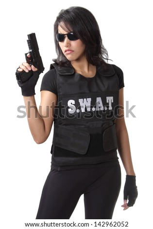 asian woman wearing swat bulletproof vest and holding a gun on her hand - stock photo
