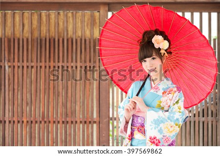 Asian woman wearing traditional japanese kimono - stock photo