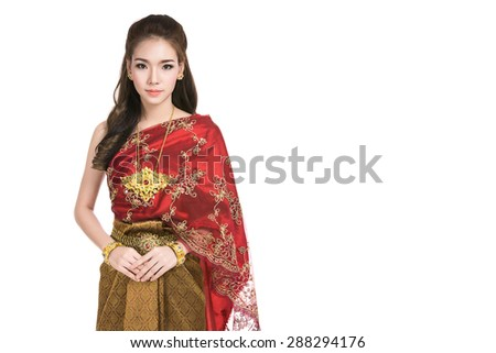 Asian woman wearing typical (traditional) red Thai dress,vintage original Thailand attire ,identity culture of Thailand,Thai girl,Happy asian woman with blank copyspace,isolated on white background - stock photo