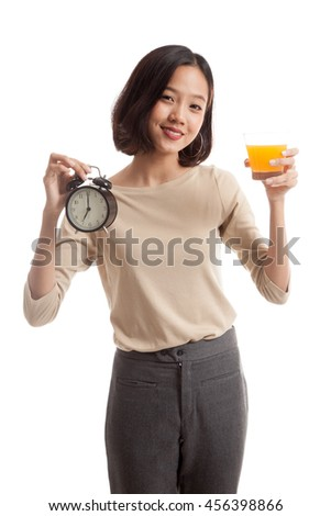 Asian woman with a clock drink orange juice  isolated on white background