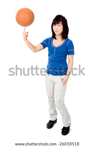 Asian woman with basketball ball spininng on finger - stock photo