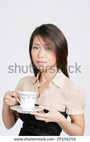 Asian woman with cup of coffee or tea