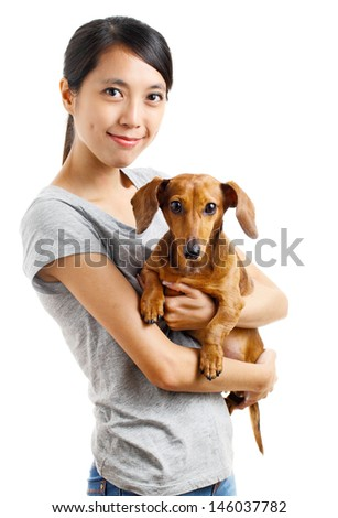 Asian woman with dachshund dog
