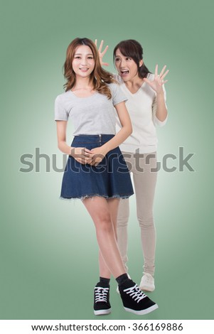Asian girl tieds hands above head