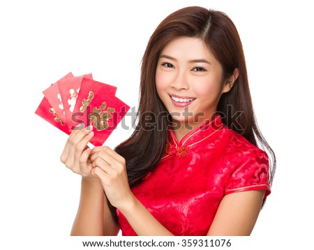 Asian woman with red pocket for chinese new year - stock photo
