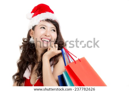 Asian woman with santa dress holding colorful shopping bags